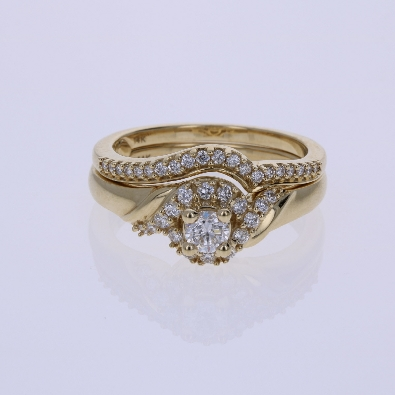 Diamond Engagement Ring 50ctw I1 HI center diamond is 20ct set in a 14k yg mounting with a halo style head  There are 16 round diamonds down the shank and around the halo style head  Diam  16ctw I1 H on each side  A 14k yg fitted band w 20