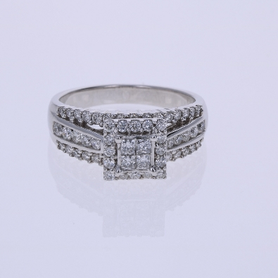 Diamond Engagement ring  This ring is 10K white gold with three rows of round diamonds down each side of the shank all prong set 34 total  The center is a halo design with the center having four princess cut tension set and 16 round diamonds in t