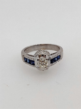18kt white gold sapphire and oval cut diamond ring  sapphire 0.56CT diamond 0.6CT size 6.5