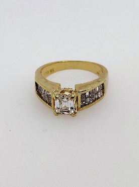 18kt yellow gold diamond engagement ring by Michael Werdiger International with four prong set 0.75ct emerald cut center diamond VS2/ H. Has alternating princess cut and straight baguette side diamonds in channel and illusion setting. Approx 0.60 ctw sides VS2-SI1/H-I. Size 7.75.