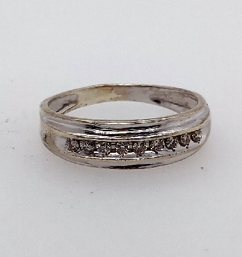 10kt white gold channel set diamond band with 9 dias .13ct tdw. I1/I-J. Size 6.