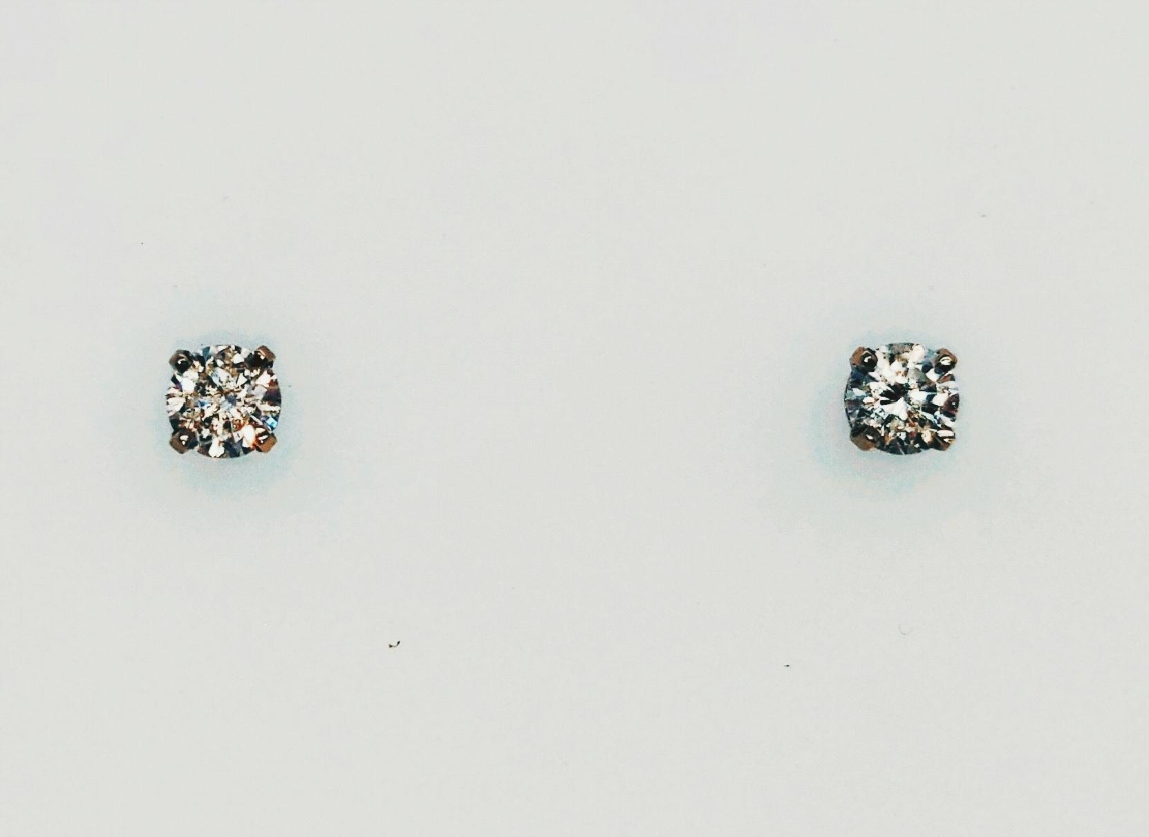 14k wg diamond studs w/continuum backs. SI2/I1; I/J .56 tdw