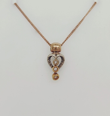 14K Two Tone Gold Heart Pendant with 3 Diamond Accents on a 16 inch chain