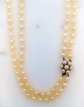 Double strand Akoya 6-6.5mm pearls with cluster pearl clasp.