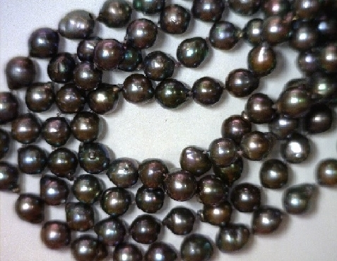 Cultured Akoya semi-baroque dyed black pearl necklace w/ 14k yellow gold clasp. 35