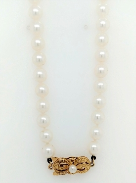 18   6.5mm Mikimoto cultured Akoya pearl necklace with 18k yellow gold clasp.