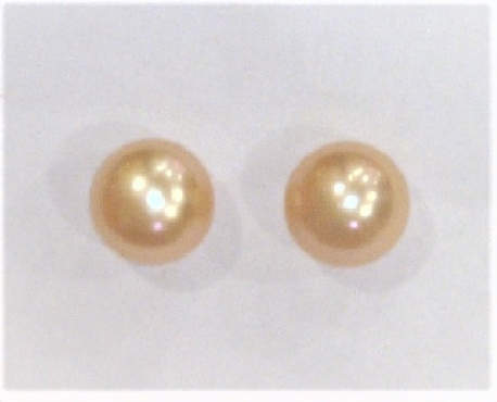Sterling silver freshwater peach pearl stud earrings.