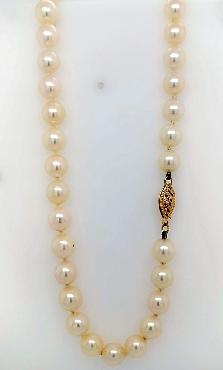 Peach 7.5mm saltwater knotted pearl necklace with 14k yellow gold clasp. 25
