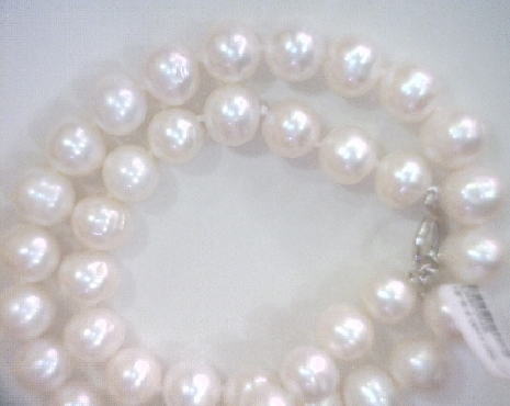White baroque pearl necklace with sterling silver clasp.
