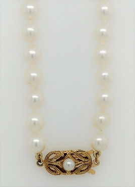 17   AA+ 6mm Akoya pearl necklace with 18k yellow gold clasp.
