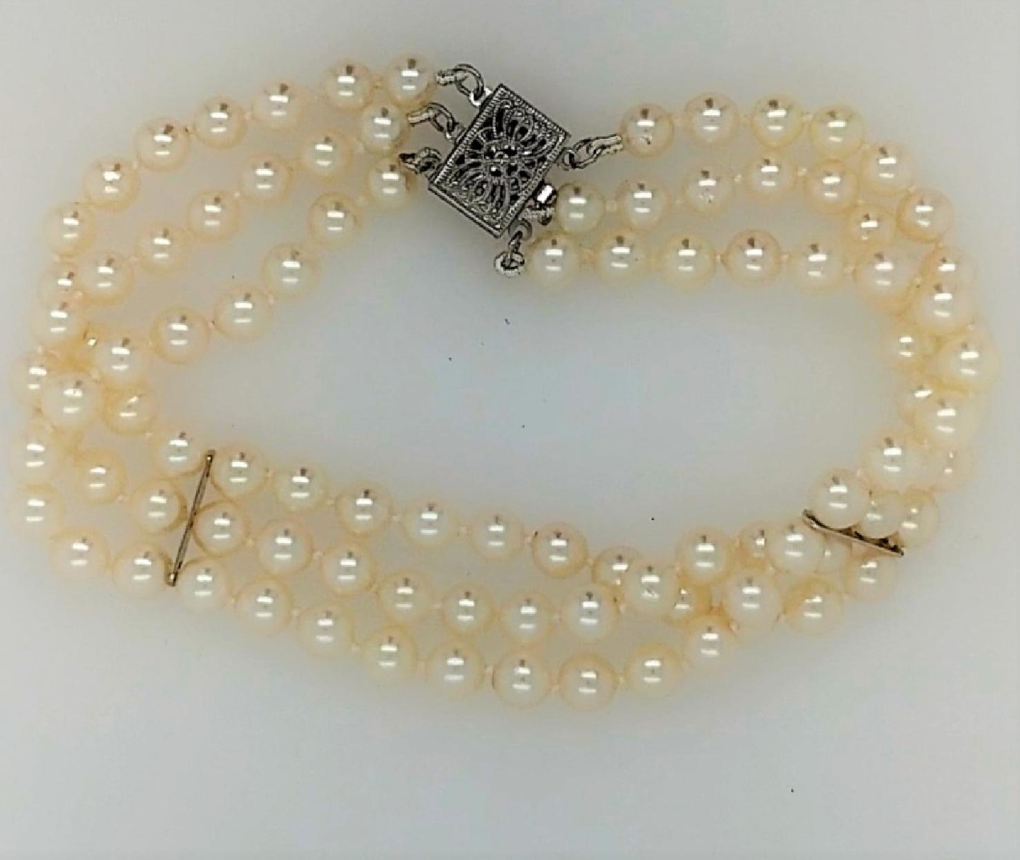 Triple strand 4-5mm Akoya pearl bracelet with 14k white gold clasp. 7.5