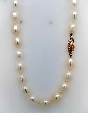 17.5   ivory freshwater pearl necklace with 14k yellow gold clasp.