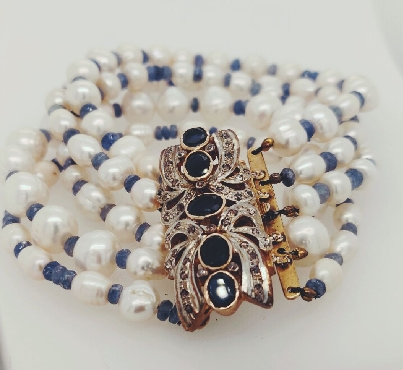 Plated Sterling Five Strand Freshwater Pearl Bracelet with Blue Stones and Embellished Clasp