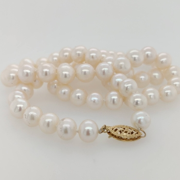 Strand of 7.5mm Freshwater Pearls with a 14K Yellow Gold Clasp; 18 inches