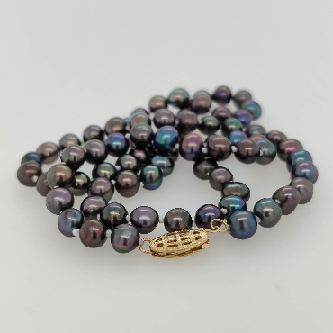 Strand of 5.5mm Black Freshwater Pearls with a 14K Yellow Gold Clasp; 18 inches