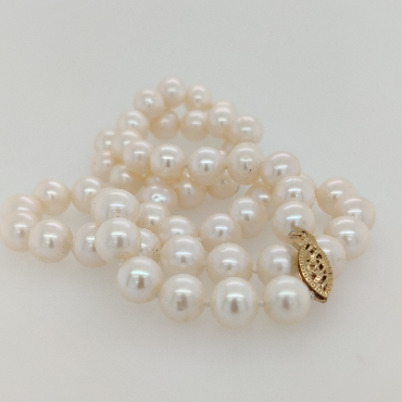 Strand of 8-8.5mm Freshwater Pearls with a 14K Yellow Gold Clasp; 20 inches