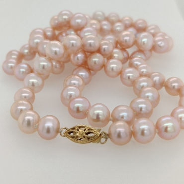 Strand of 7.5mm Pink Freshwater Pearls with a 14K Yellow Gold Clasp; 25 inches