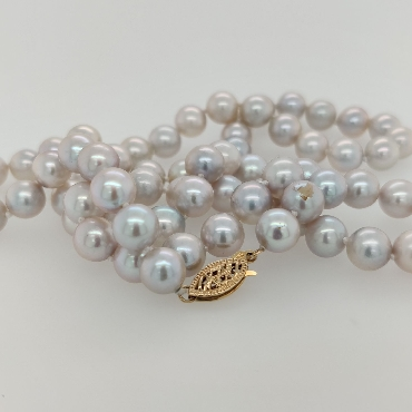 Strand of 7mm Silver Freshwater Pearls with a 14K Yellow Gold Clasp; 23 inches