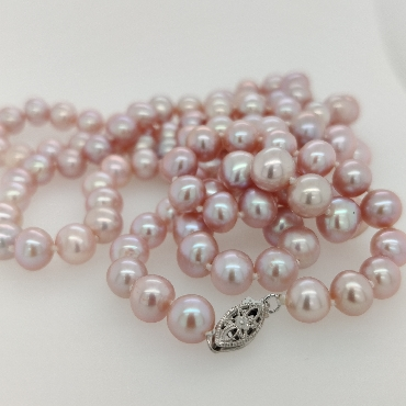 Strand of 7mm Pink Freshwater Pearls with a 14K White Gold Clasp; 35.5 inches