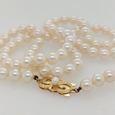 Vintage Mikimoto   A   Grade 6mm Akoya Pearl Necklace with 18K Yellow Gold Clasp; 22 inches