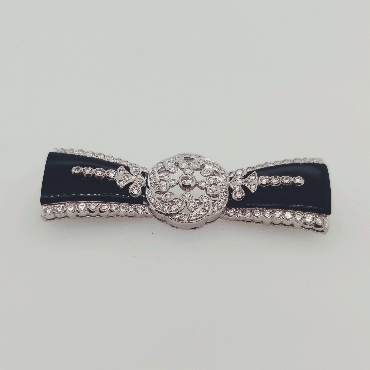 18K White Gold and Onyx Art Deco Bow Brooch with Diamonds