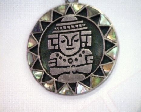 Mayan sterling silver and mother of pearl pendant.