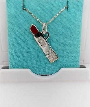 Sterling Silver Tiffany & CO Necklace with Clinique 45 Year Anniversary Lipstick Charm. Comes with Original Box