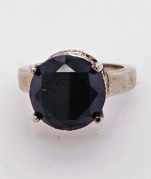 Sterling Silver Black Diamond Solitaire Ring  Size 7  Weight: 8.13 CT Shape: Round Cut: Brilliant Clarity: Opaque Color: Jet Black Treatment: Color Enhanced (Heat & Irradiation)