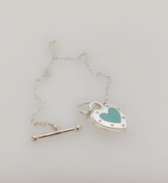 Tiffany & CO Sterling Silver Love Heart Toggle Bracelet with Blue Enamel Finish   Comes with Box and Pouch