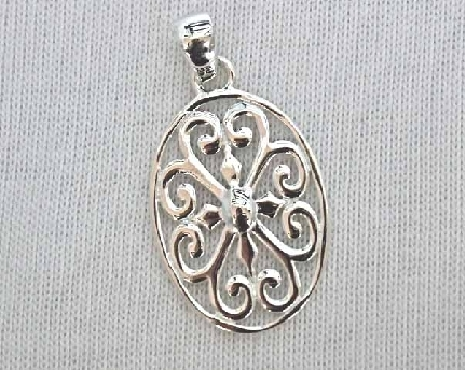 Southern Gates Sterling Silver pendant; oval with heart design small. 1-3/8   high including bale by 3/4   wide (approx.) P204