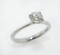 14K white gold engagement ring set with:  - Ideal round brilliant cut diamond by Hearts On Fire; 0.540ct F;SI1 (HOF59736)