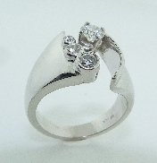 14KW diamond engagement ring by Studio Tzela set with: - 0.331ct G; SI1 ideal cut; round brilliant cut diamond by Hearts On Fire; HOF101530 - accented with 3 ideal cut; round brilliant cut diamonds by Hearts On Fire: 0.14ct; 0.066ct; and 0.024ct -