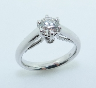 18KW engagement ring by Studio Tzela set with: - 0.73ct ideal cut; round brilliant cut Hearts On Fire diamond; G; VS1 HOF29504 AGS #0002934207 - 2 ideal cut; round brilliant cut Hearts On Fire diamonds; 0.04cttw; VS/SI