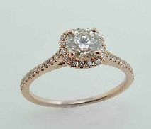 14 Karat rose gold diamond engagement ring set with: - 0.536 carat Hearts On Fire diamond; I; VS2 (HOF118360) - 54 round diamonds = 0.26 cttw H/I; SI