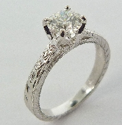 14K white gold engagement ring; set with one 0.78ct G SI1 ideal round brilliant cut diamond by Hearts On Fire (HOF71037). Accented with four Si-VS ideal round brilliant cut diamonds by Hearts On Fire; totaling 0.027carat.