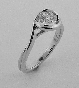 18 karat white gold engagement ring. Set with one 0.646 carat Hearts On Fire diamond; I; VS1; HOF119245