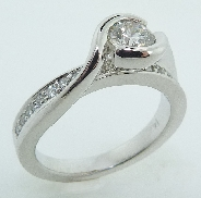 14KW diamond engagement ring set with:  - an ideal round brilliant cut diamond by Hearts On Fire; 0.513ct I; VS2 (HOF54021).  - 0.28cttw excellent-very good cut diamonds; G/H; VS2-SI1