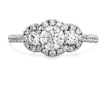 Platinum engagement ring known as;   Transcend 3 Stone   by Hearts On Fire Set with ideal round brilliant cut diamonds by Hearts On Fire:     -Center: 0.548ct (HOF120693) Sensational Series H VS2     -Accented with side and halo diamonds; 1.24 cara