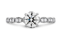 18K white gold diamond engagement ring; named   Lorelei Floral    by Hearts On Fire. Set with one 0.510 carats G SI1 Sensational Series ideal round brilliant cut diamond by Hearts On Fire. (HOF137340) Accented with GH VS-SI ideal round brilliant cut