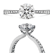 18K white gold engagement ring known as   Signature   by Hearts On Fire set with:  - 0.71 ct I; VS1 ideal; round brilliant cut diamond by Hearts On Fire (HOF117219) - accented with 0.14 cttw ideal; round brilliant cut diamonds by Hearts On Fire