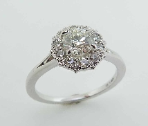 18KW Liliana Halo engagement ring by Hearts On Fire set with:  - 0.578 ct; I; VS1 HOF155289  - 0.88 cttw; I/J; VS-SI1