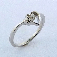 14K white gold custom open heart ring -set with one ideal round brilliant cut diamond by Hearts On Fire; 0.03ct SI; G/H