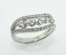 18K white gold ring; known as  Succession Journey Mini Right Hand Ring  by Hearts On Fire -set with ideal round brilliant cut diamonds by Hearts On Fire; 0.86 carat total weight; VS-SI; G/H