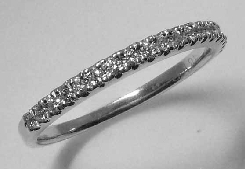 18k White gold band; micro-claw set with nineteen ideal round brilliant cut diamonds by Hearts On Fire; totaling 0.134 carats.; G-H VS-SI.