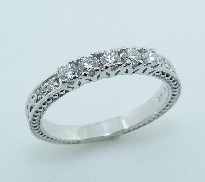 14KW lady s Hearts On Fire wedding band set with: - 9 Hearts On Fire diamonds; 0.31cttw; G/H; VS2-SI1