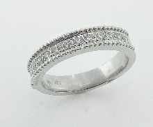 18K white gold wedding band; set with ideal round brilliant cut diamonds by Hearts On Fire; 0.26 carat total weight; VS-SI; G/H