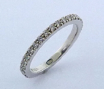 18K white gold wedding band; set with ideal round brilliant cut diamonds by Hearts On Fire; 0.36 carat total weight; VS2-SI1; G/H