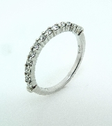 18K white gold band. Set with ideal round brilliant cut diamonds by Hearts On Fire; 0.30 carat Total Weight G/H SI1-VS2