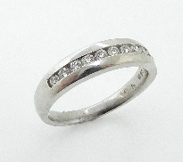 18K white gold channel set band -set with ideal round brilliant cut diamonds by Hearts On Fire; 0.30 carat total weight; SI; G/H