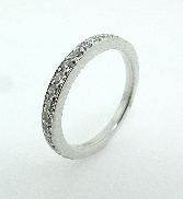 18K white gold band; known as  Truly Bridal Band  by Hearts On Fire -set with ideal round brilliant cut diamonds by Hearts On Fire; 0.39 carat total weight; VS-SI; G/H